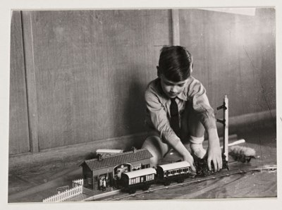 Boy-playing-with-a-train-set